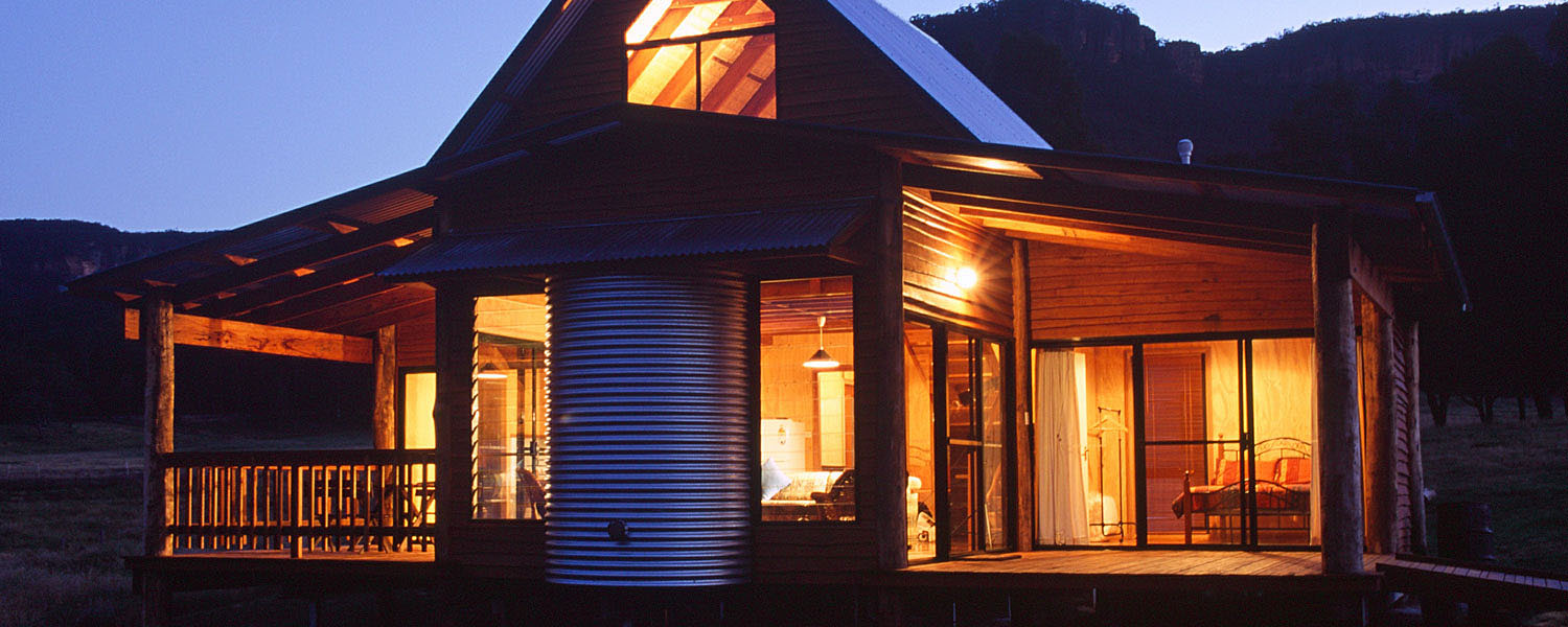 The Woolshed Cabins at night.